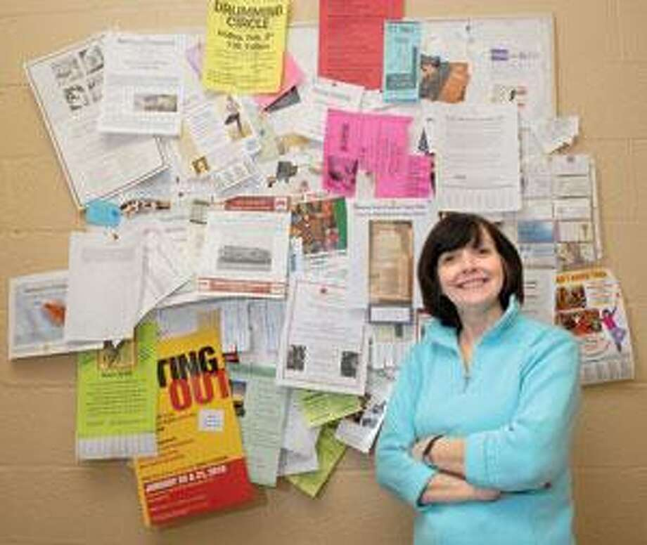 Linda Mooser, owner of Books & Company in Hamden, keeps a community bulletin board in the back of her store. Unlike some boards, she allows people to add to the board without her intervention. RIGHT: This bulletin board is on York Street, between Toad's Place and Mory's, a private dining club at Yale.