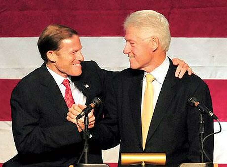 Former President Bill Clinton, right, and Connecticut Attorney General and US Senate candidate Richard Blumenthal, at a rally for Blumenthal at Wilbur Cross High School Sunday. (Brad Horrigan/Register)