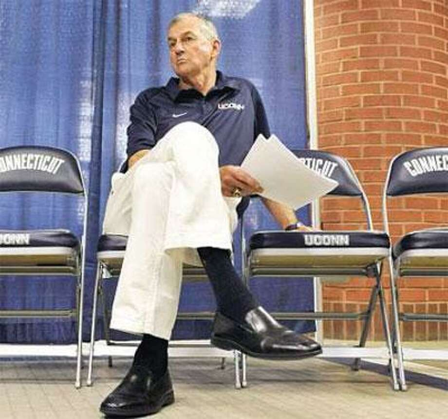 University of Connecticut basketball head coach Jim Calhoun waits during a press conference in Storrs Friday to discuss NCAA violations found in the men's program. (Associated Press)