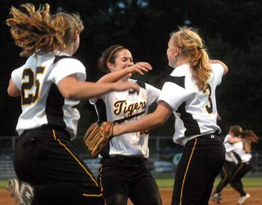 New Haven Register.  BH0593.West Haven, Connecticut - 05.27.10:  Hand players Katelyn Wall, facing, and Allison Ruggiero celebrate after Wall crosses the plate during the 6th inning.