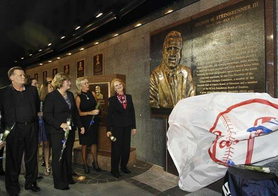Members of the Steinbrenner family gather for a ceremony dedicating a monument to the late Yankees owner George Steinbrenner before the Yankees' baseball game against the Tampa Bay Rays at Yankee Stadium in New York, Monday, Sept. 20, 2010. From left are son Hank Steinbrenner, daughters Jessica Steinbrenner and Jennifer Steinbrenner Swindal, and Steinbrenner's widow, Joan Steinbrenner.  (AP Photo/Kathy Willens, Pool) Photo: AP / POOL AP