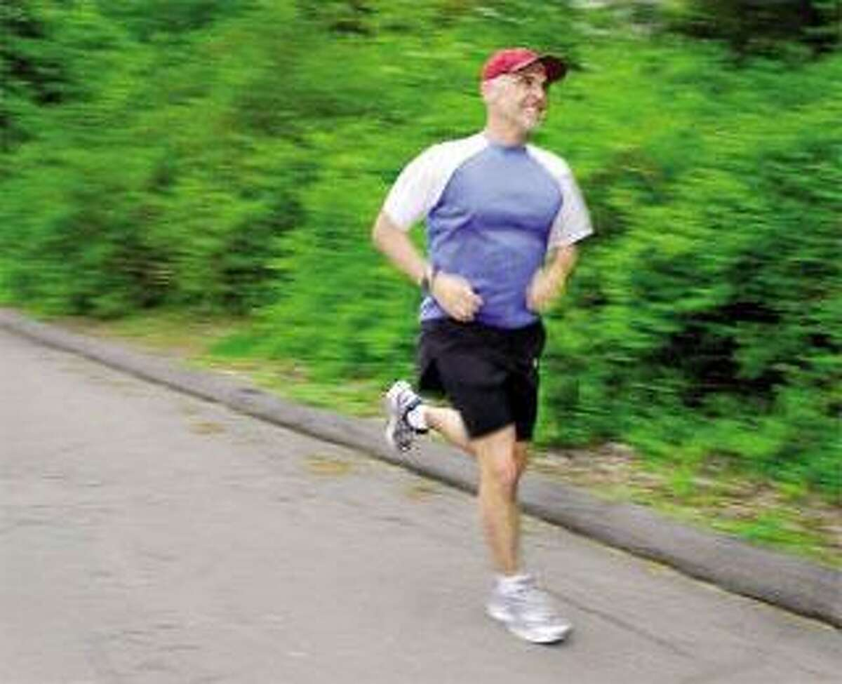 Fred Murolo of Cheshire has run every day since Dec. 30, 1981. His 10,001st consecutive run is today. (Peter Hvizdak/Register)