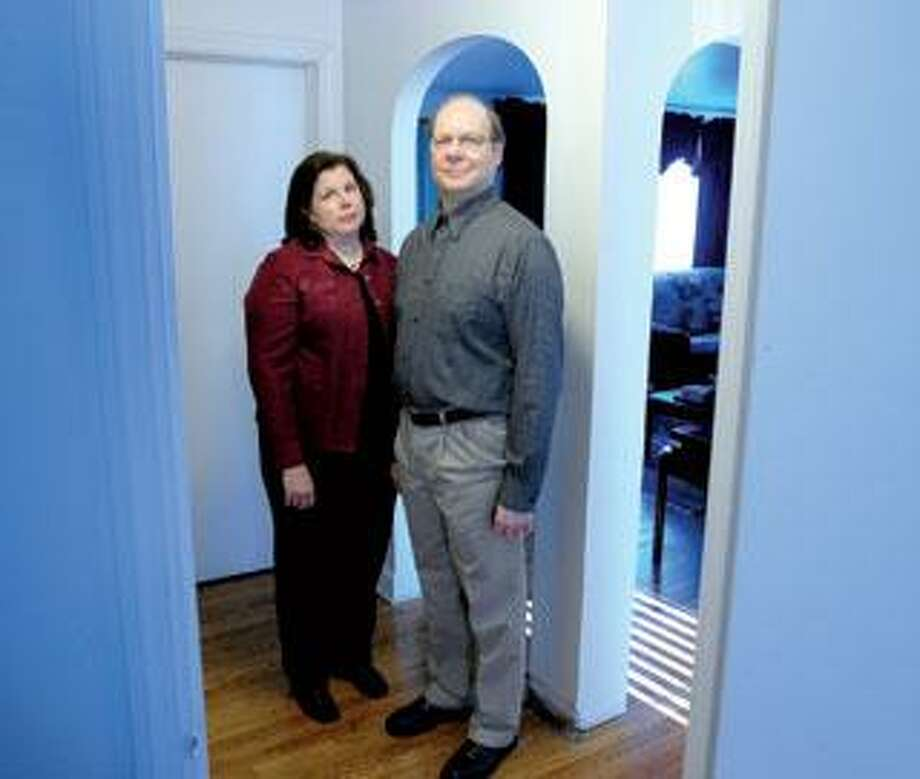 Doreen DeLorenzo and her husband, Dennis, who has early onset dementia are photographed in their home in Millord. (Arnold Gold/Register