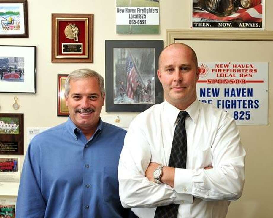 Patrick Egan, right, is being promoted to Assistant chief on the New Haven Fire Department. Egan is currently President of the Firefighters Union, a post he will have to leave. On the left is Vice President James Kottage, who will take over Egan's Post at the Union. (Photo/Peter Casolino)