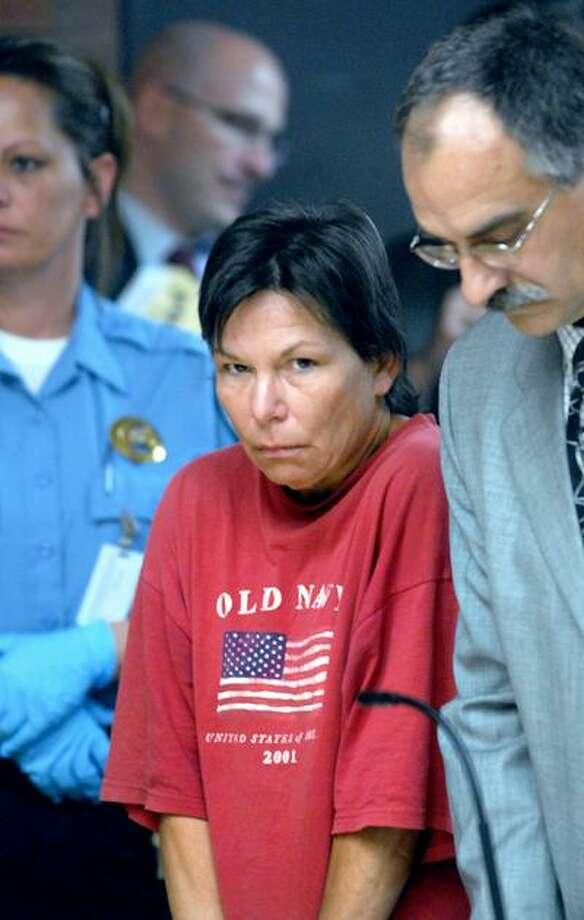Mary Ames (center) is arraigned in Superior Court in Meriden on 5/24/2010 for the fatal stabbing of a bartender in North Haven.Photo by Arnold Gold   AG0364D