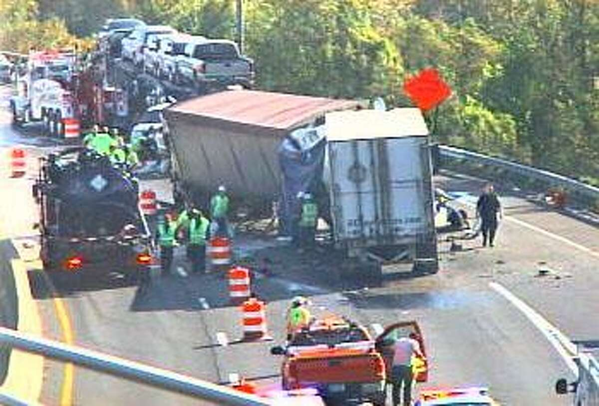 (CT DOT CAMERA) Workers clear the scene of the I-95 crash.