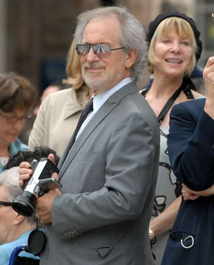 5/24/10 7YaleML0606DYale's 309th Commencement: director Steven Spielberg is just another dad with a video camera as his wife Kate Capshaw right looks on while graduates march into Old Campus. Photo by Mara Lavitt
