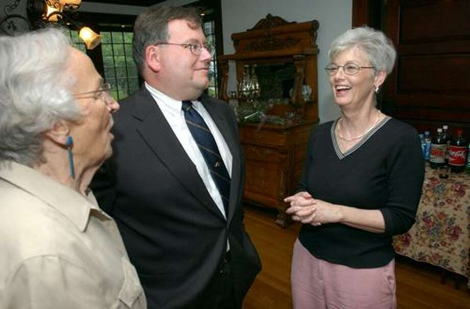 Eileen Zeender (left) and Jerry Farrell, Jr. (center) talk with Charlotte Murphy (right) at a retirement party for Murphy at Farrell's home in Wallingford in 2005. Photo by Arnold Gold/Register Staff