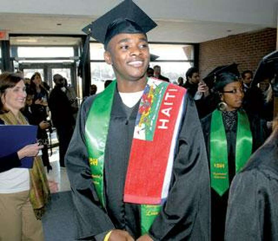 University of New Haven student James Hilaire, who was badly injured in a soccer game in 2008, graduated Saturday. He is a native of Haiti and some family members are missing following the earthquake. (Arnold Gold/Register)