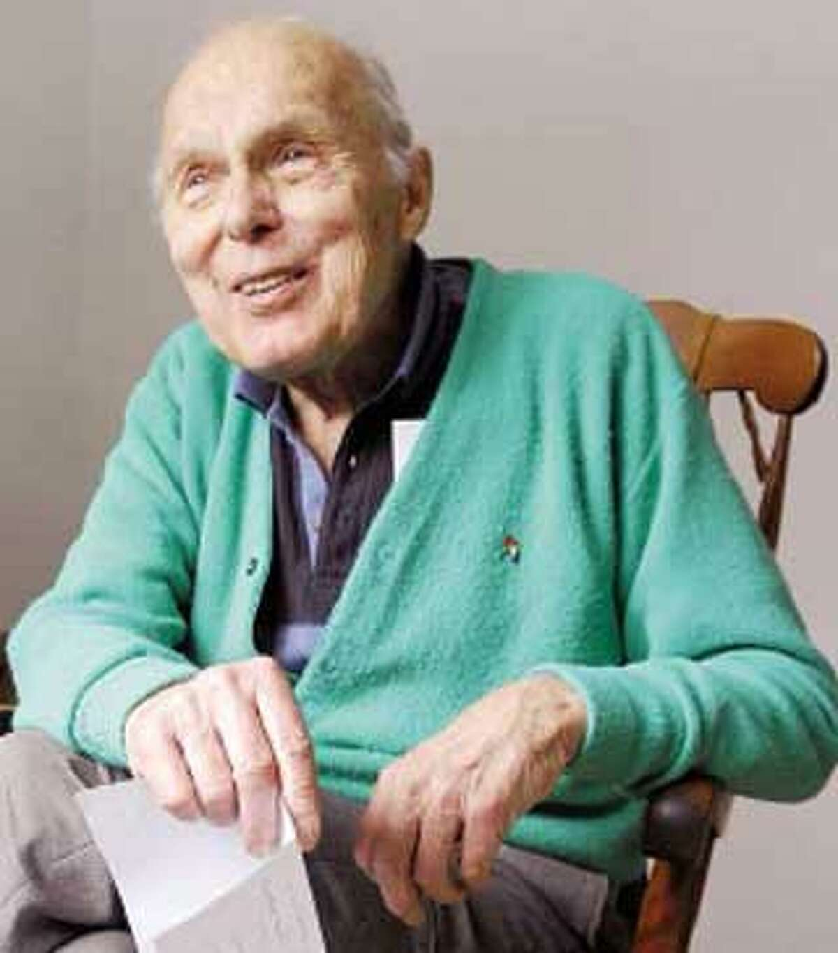 Boris Bolash, 86, a widower, holds a recent letter from a young women he met in France during World War II. He is hoping to reconnect. (Peter Hvizdak/Register)