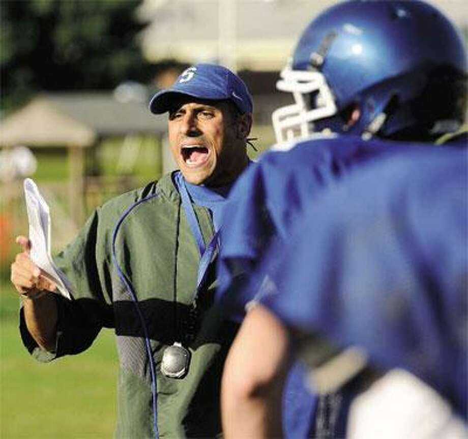 Former UConn quarterback/wide receiver D.J. Hernandez is the new head coach for the Southington High football team. (Mara Lavitt/Register)