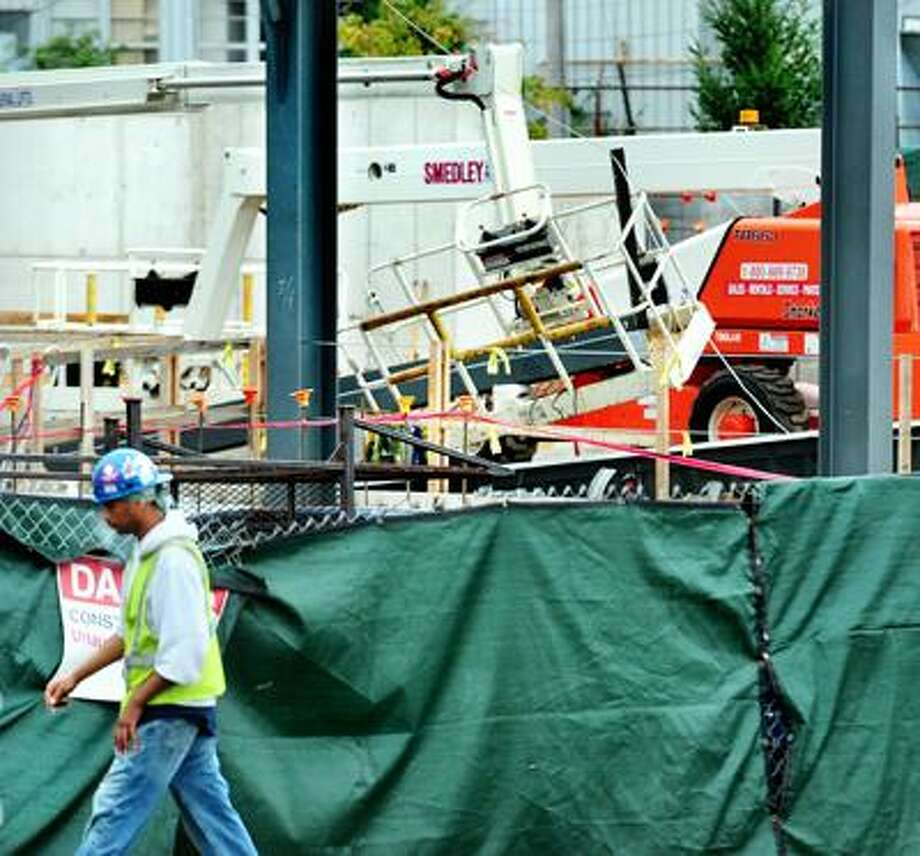 A steel beam rests on a cherry picker where it fell at a chilled water facility under construction at Science Park in New Haven on 9/13/2010.Photo by Arnold Gold   AG0385A
