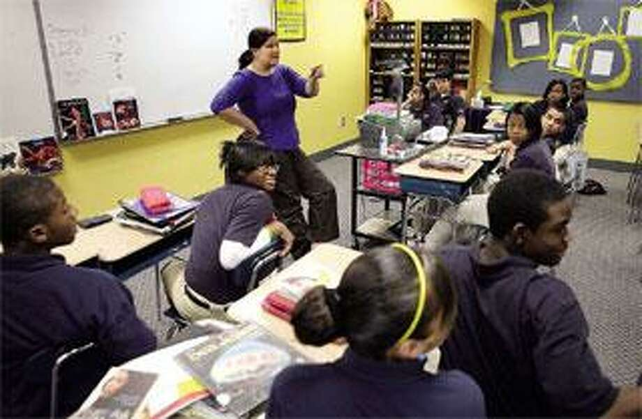 Teacher Carla Seeger works with an eighth-grade algebra class at Amistad Academy. (Peter Casolino/Register photos)