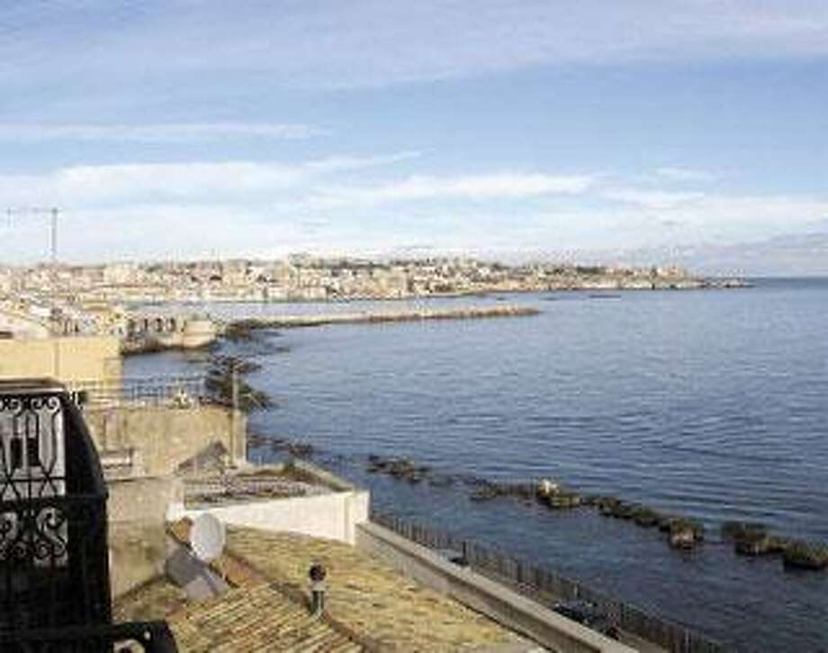 TheMediterranean laps the eastern shore of the island of Ortigia, the Siracusa neighborhood that houses architectural treasures ranging from ancient Greek to Baroque. (Associated Press)
