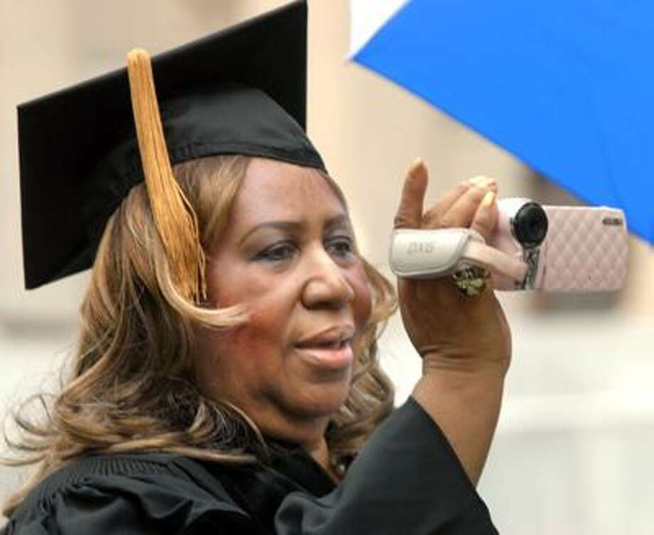 Yale's 309th Commencement: singer Aretha Franklin videotapes outside Woodbridge Hall at Yale before receiving her honorary doctor of music during commencement exercises at Yale. Photo by Mara Lavitt