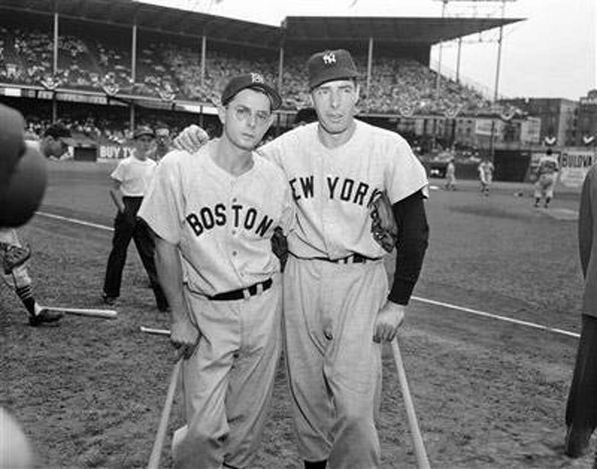 Dom DiMaggio of the Boston Red Sox, left, and his brother Joe DiMaggio of the New York Yankees are shown, in this July 12, 1949 file photo. Dom DiMaggio, a seven-time All Star who still holds the record for the longest consecutive game hitting streak in Boston Red Sox history died early Friday morning May 8, 2009 at his Massachusetts home. He was 92. (AP Photo/Ray Howard, File)