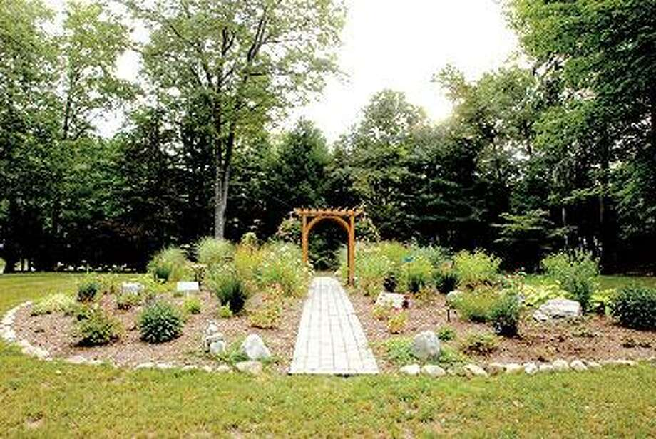 A memorial garden on the site of the former Petit Family home on Sorghum Mill Drive and the corner of  Hotchkiss Ridge Road in Cheshire that was torn down for the garden and where Jennifer Hawke-Petit, 48, was murdered along with her two daughters, Hayley, 17, and Michaela, 11. Suspects Steven J. Hayes and Joshua Komisarjevsky were arrested and charged with their murders.