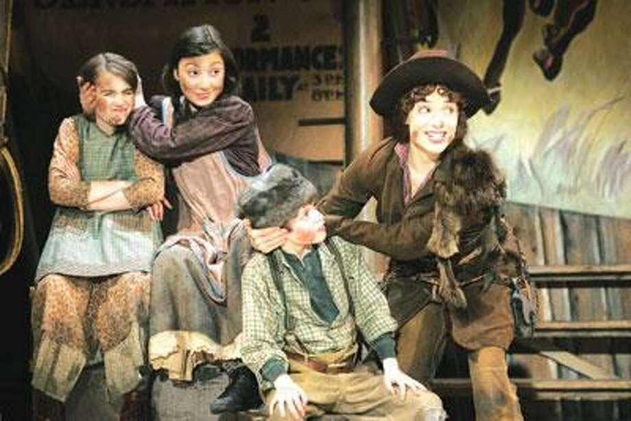 "Griffin Birney (Little Jake), front, and Marissa Smoker, back, both of Branford, along with Joy Rachel Del Valle (Jessie), play the siblings of Annie Oakley (Jenn Gambatese) in ""Annie Get Your Gun"" at Goodspeed. (Diane Sobolewski)"