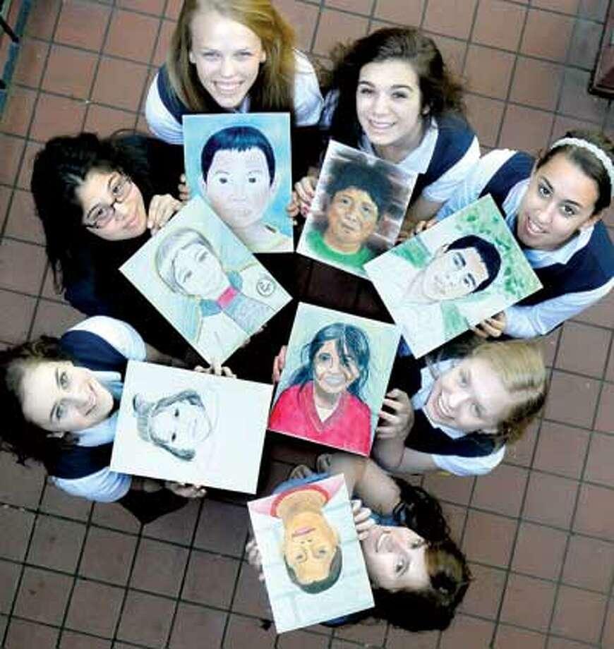 Lauralton Hall high school students, clockwise from bottom, Emma Molloy, Chloe Walker, Davian Manlapit, Teresa Starzecki, Becca Mancini, Catherine Amato and Mary Watson display their portraits of Peruvian orphans. (Arnold Gold/Register)