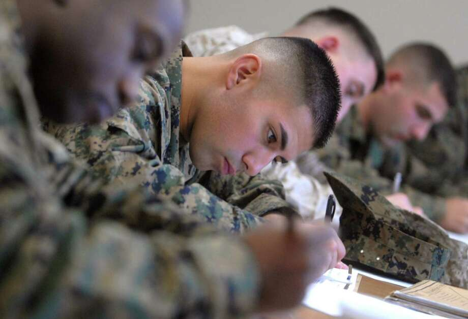 Lance Cpl. Ricky Panchana, of Holbrook, NY, fills out some paperwork at the U.S. Marine Corps Reserve Center in New Haven Wednesday morning.  Panchana and others from the First Truck Platoon of New Haven 6th Motor Transport Battalion returned from Iraq Friday night. Photo by Brad Horrigan