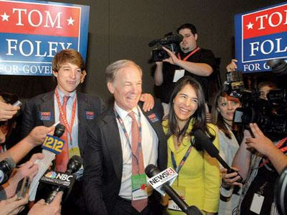 Tom Foley, center, celebrates after receiving the Republican Party's nomination for governor Saturday with his wife, Leslie Fahrenkopf, and son, Tom Foley Jr. (Mara Lavitt/Register)