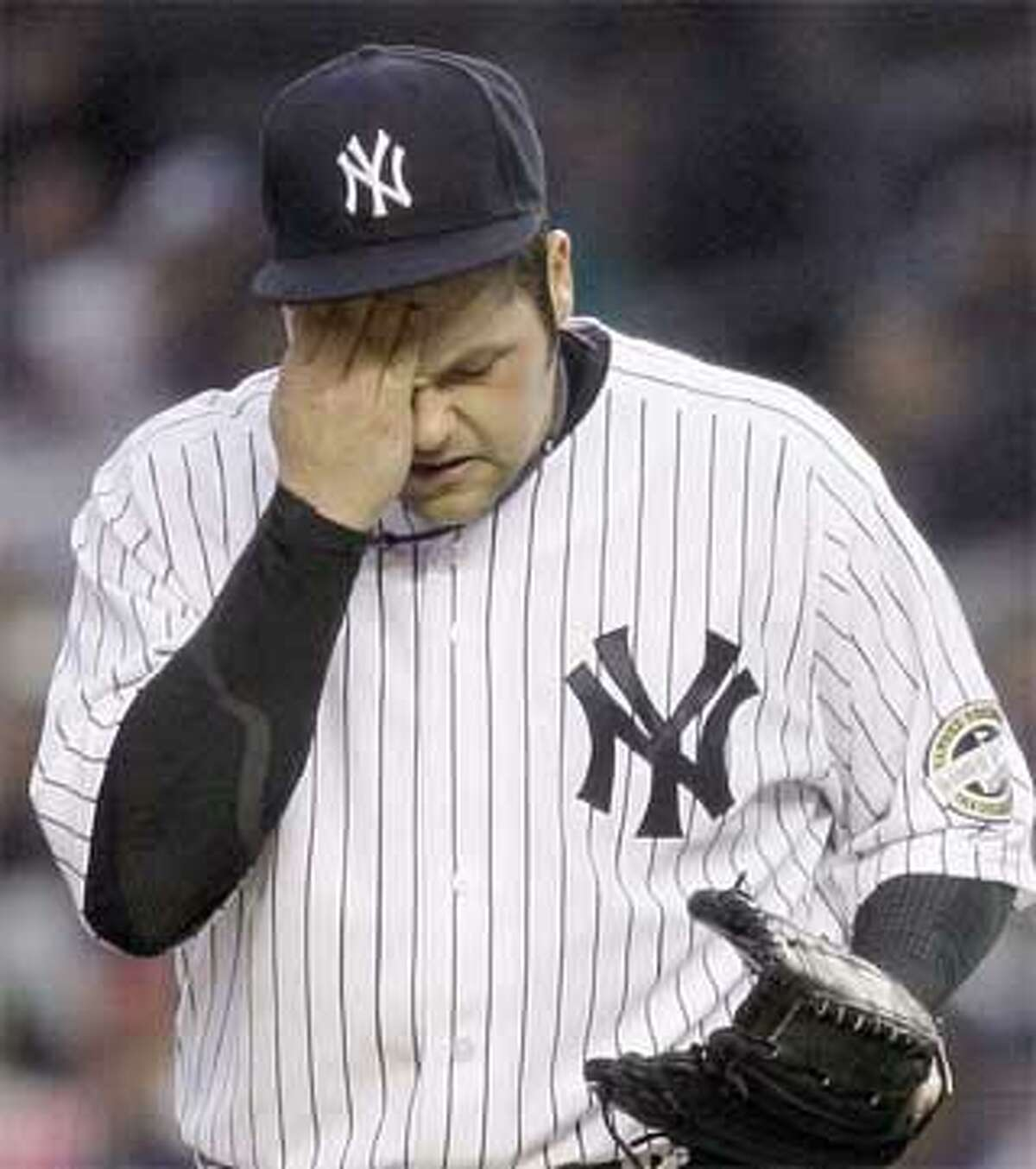 Joba Chamberlain had a rough first inning Tuesday night at Yankee Stadium but eventually settled down and struck out 12 Red Sox in his 5(TM) innings worth of work. The game was not completed in time for this edition. Check out nhregister.com to find out what happened. (Associated Press)