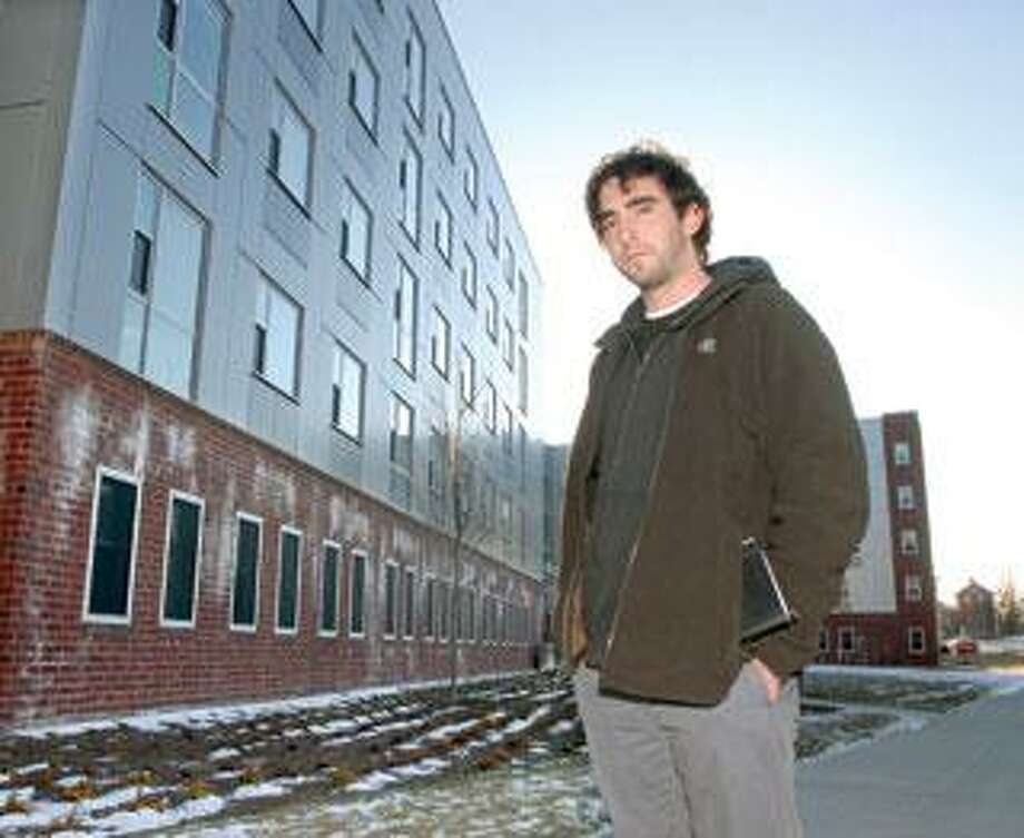 University of New Haven junior Jeremy Whitney of Newtown stands outside Soundview Hall, a new UNH dorm that will house freshmen and sophomores. UNH is no longer guaranteeing on-campus housing for upperclassmen. (Mara Lavitt/Register)