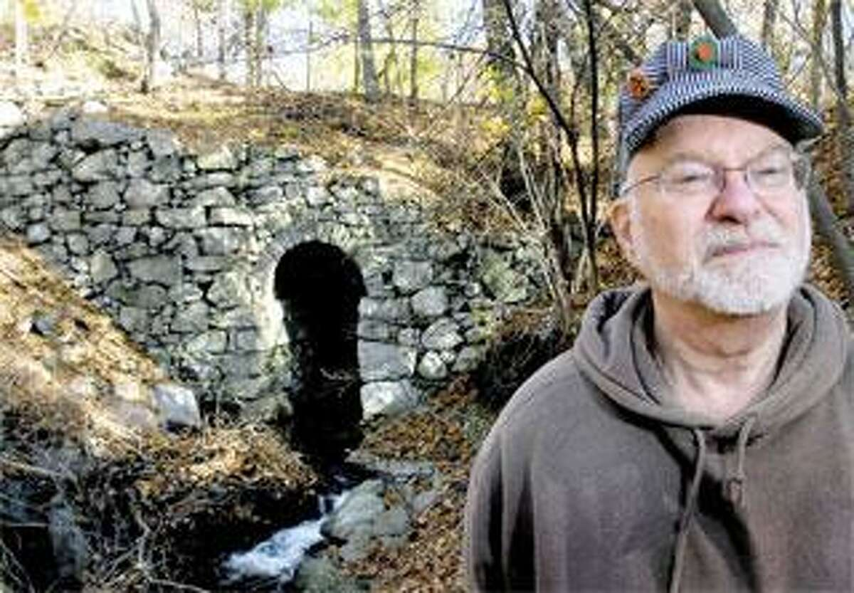 Bob Belletzkie of Prospect hunts for remnants of Connecticut railroads. This culvert was built over Davis Brook in Derby for the New Haven & Derby Railroad line. He posts his discoveries on TylerCityStation. info. (Arnold Gold/Register)