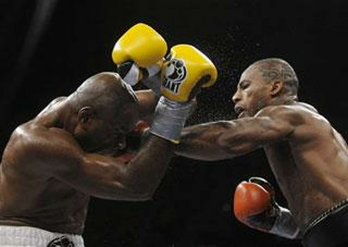 Chad Dawson, right, trades punches with Glen Johnson, during their WBC Interim / IBO Light Heavyweight Championship fight in Hartford, Conn., on Saturday, Nov. 7, 2009. Dawson won in 12 rounds with a unanimous decision. (AP Photo/Fred Beckham)