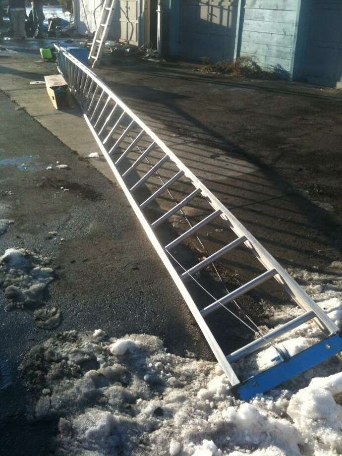 The ladder on the ground came in contact with the wire. Photo by Chief John J. Ahern.