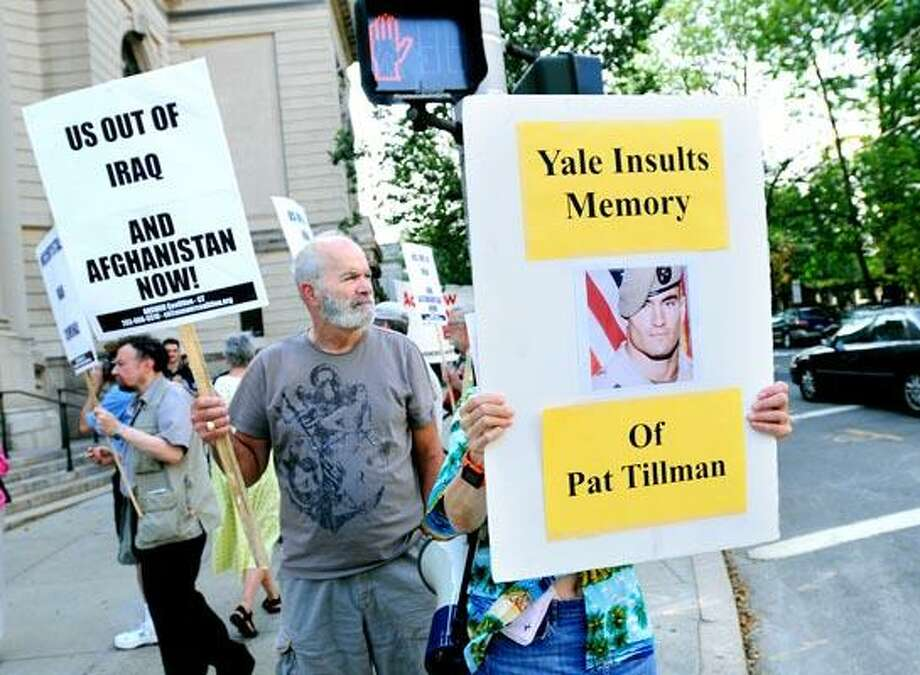 Jim Duerte (center) of New Haven was among those protesting the hiring of retired General Stanley McChrystal as a teacher at Yale University at the corner of Grove and College Sts. in New Haven on 9/1/2010.Photo by Arnold Gold   AG0383E