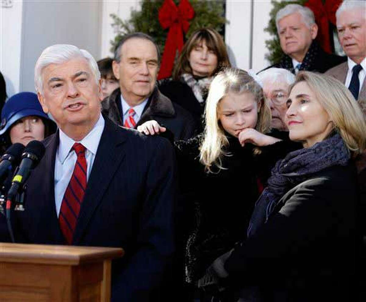 U.S. Sen. Christopher Dodd, D-CT, announces that he will retire after his current term outside his home in East Haddam, Conn., Wednesday, Jan. 6, 2010. Dodd, who served five terms, is chairman of the Senate Banking Committee and made an unsuccessful bid for the presidency in 2008. At right is is wife Jackie and daughter Christina. (AP Photo/Charles Krupa)