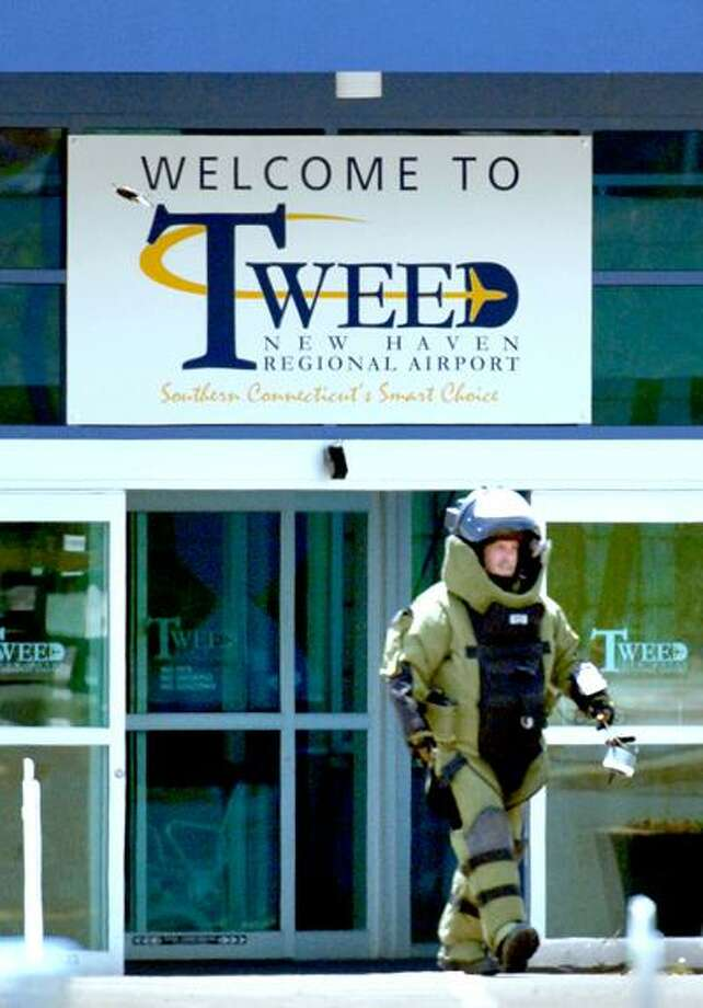 A member of the New Haven Police Department's bomb squad investigates a suspicious package left near the entrance to Tweed New Haven Regional Airport on 5/14/2010.Photo by Arnold Gold   AG0363D