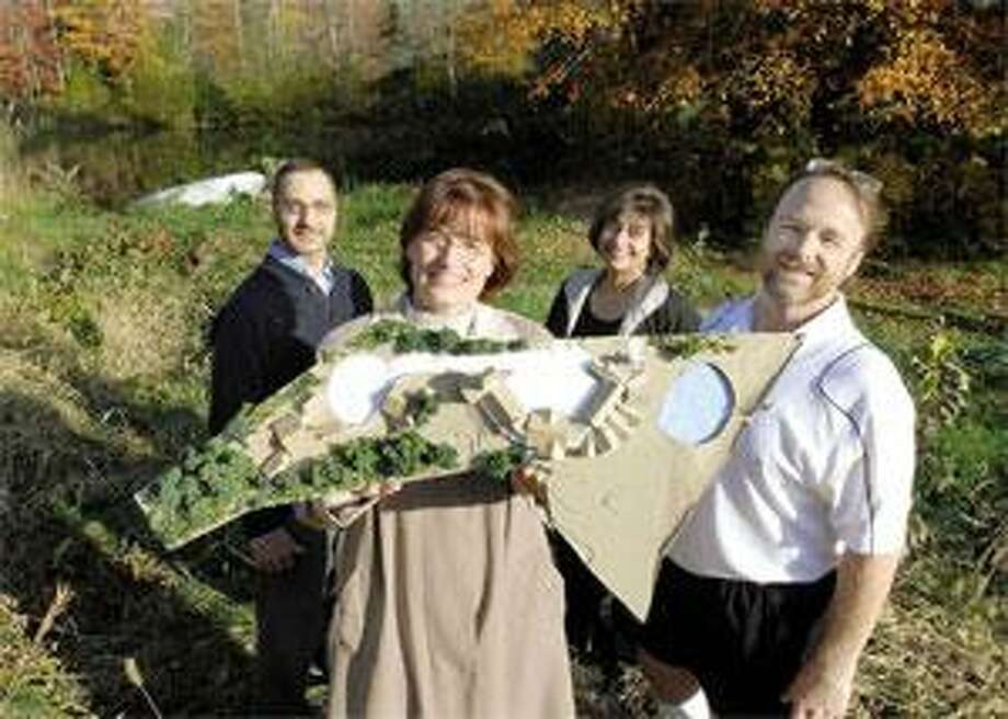 Among those involved with the proposed Sunshine House hospice in Madison are, from left, family representative Bob Franchini of Branford, CEO Amy Kuhner of Madison, holding a model of the planned facility, treasurer Camille Murphy of Guilford and architect Duo Dickinson of Madison. (Mara Lavitt/Register)