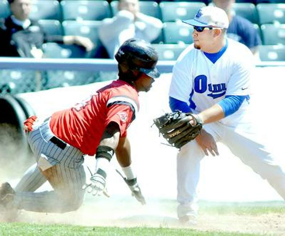 Sean Burke (left) of the Dominican Chargers is safe at third base after tagging up as A.J. Rouleau (right) of Southern tries to field the throw in the third inning during a Division II Baseball Championship East Regional game at Yale Field on (Arnold Gold/Register)