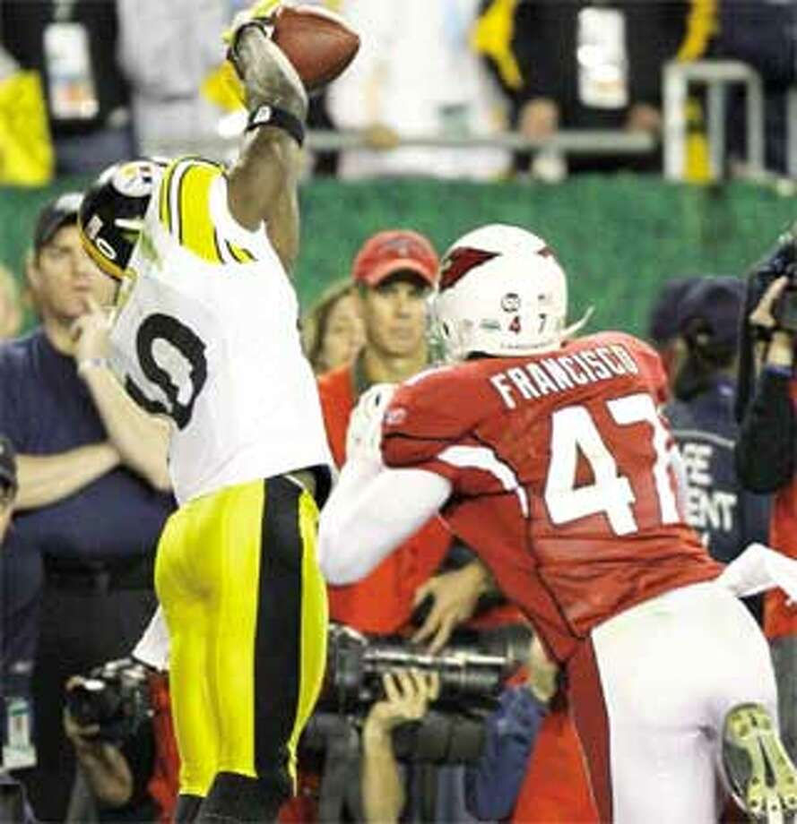 Pittsburgh Steelers wide receiver Santonio Holmes hauls in a 6-yard touchdown reception past Arizona Cardinals safety Aaron Francisco late in the fourth quarter of the Super Bowl Sunday. Holmes finished with 131 yards receiving and a touchdown and was named the game's MVP. (Associated Press)