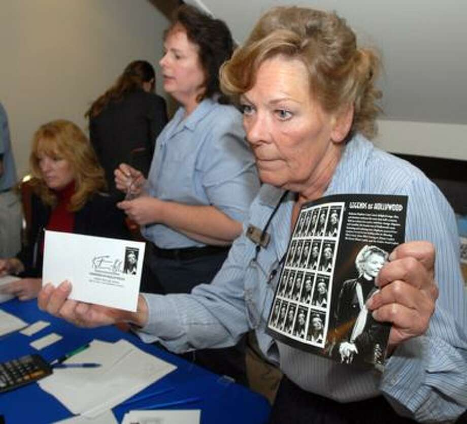 The Katharine Hepburn Cultural Arts Center in Old Saybrook was the location for the dedication ceremony to the First Class Stamp issued in her honor today. Selling the stamps and the first-day covers at the event was Old Saybrook postal clerk Ann Babor of Essex. Photo by Mara Lavitt