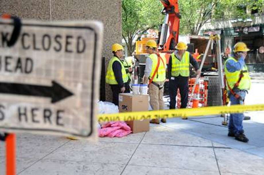 A United Illuminating crew work on an underground electrical device which caused a fire in front of the Shubert Theater late wedneday night. The ongoing work closed the portion of College avenue and a bit of the sidewalk directly in front of the Shubert for most of the day Thursday. VM Willaims 05.13.10