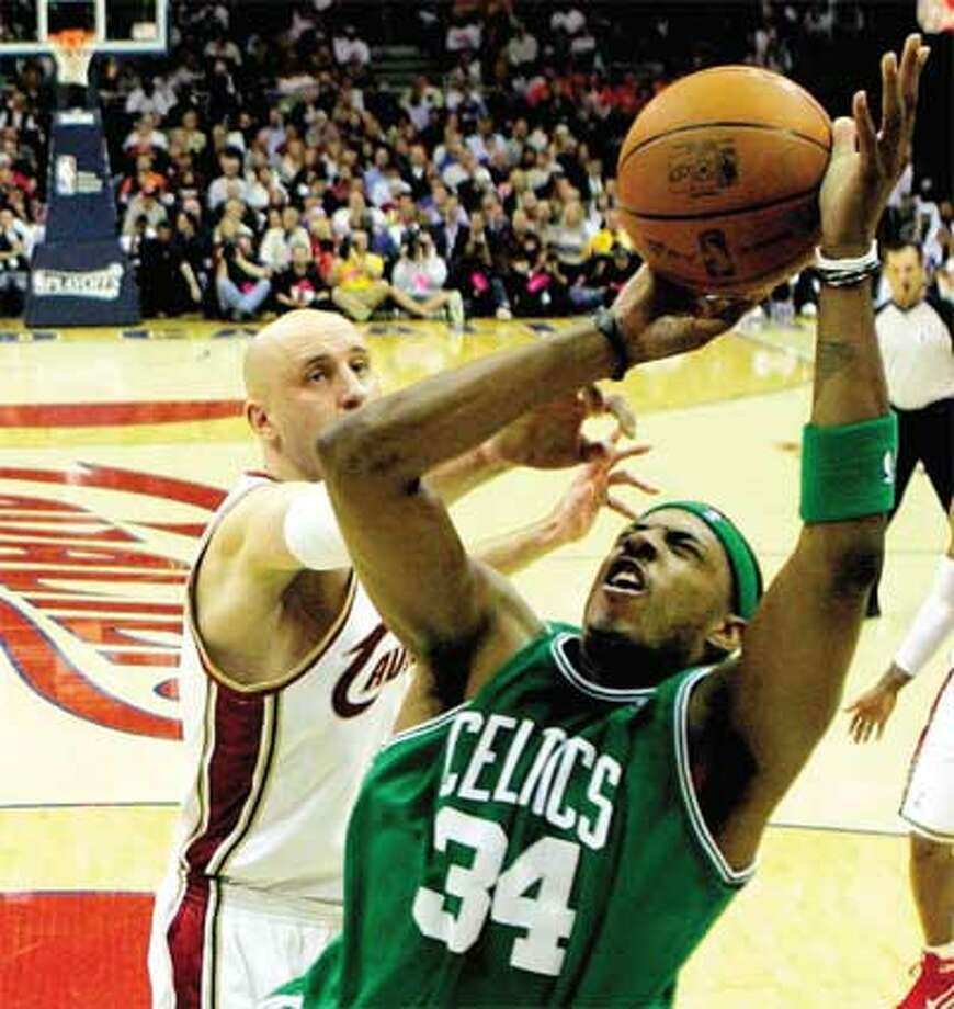 Boston's Paul Pierce gets inside position on Cleveland's Zydrunas Ilgauskas to score in the second quarter of Tuesday's Game 5 of their second-round NBA playoff series. Boston routed the Cavs 120-88 to take a 3-2 lead in the series. (Associated Press)