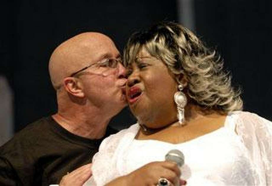 In this 2007 file photo, New Orleans blues singer Marva Wright get a kiss from Paul Shaffer, music director of Late Night with David Letterman, at the Jazz Festival in New Orleans. Wright remains hospitalized Tuesday, June , 2009 after suffering a stroke over the weekend. (AP Photo/Cheryl Gerber, file)