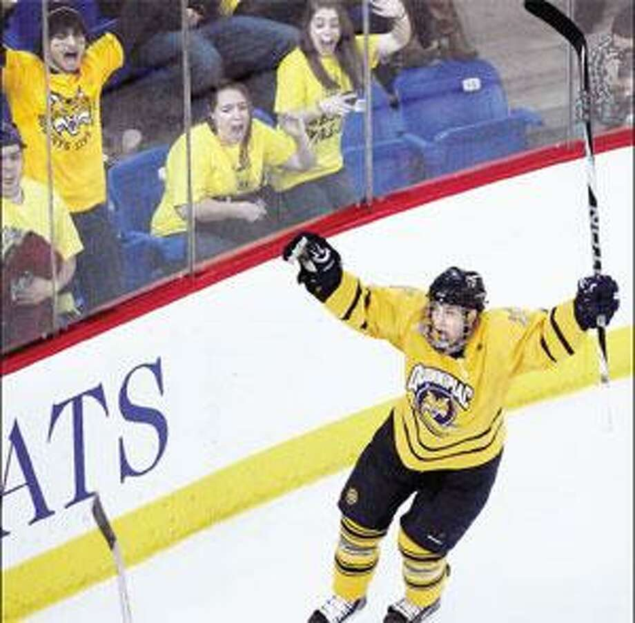 Quinnipiac's Eric Lampe celebrates his third-period goal that gave the Bobcats a 4-2 lead over Yale on Saturday. Quinnipiac held on to win 4-3. (Peter Casolino/Register)