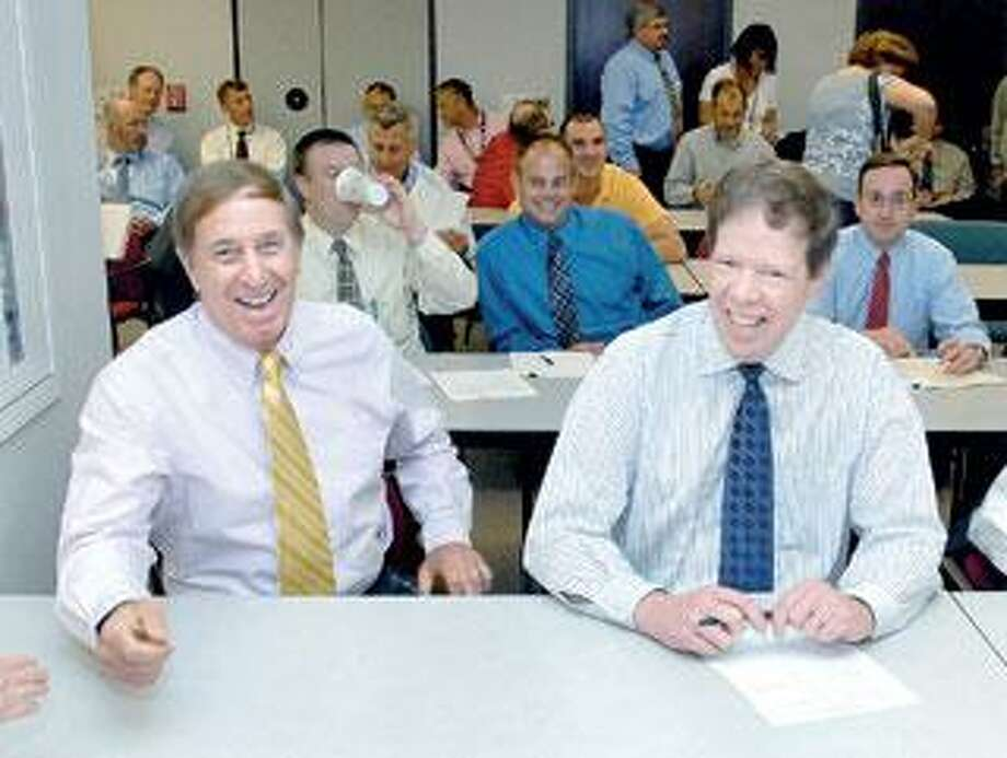 Joseph DeMarco, left, the state Department of Transportation District 3 engineer, and DOT construction division chief Mark Rolfe react Wednesday as bid results for the Q bridge project come in under estimates. (Arnold Gold/Register)