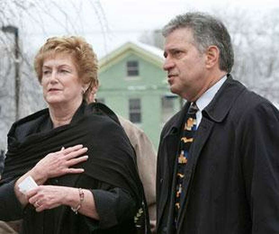 Connecticut Gov. M. Jodi Rell, left, and Middletown, Conn., Mayor Sebastian Giuliano walk into St. Mary's Church in Middletown, Conn., Saturday, Feb. 27, 2010. A memorial service was held at the church to honor the six workers who were killed in an explosion at the Kleen Energy Systems plant in Middletown earlier this month. (AP Photo/Thomas Cain)