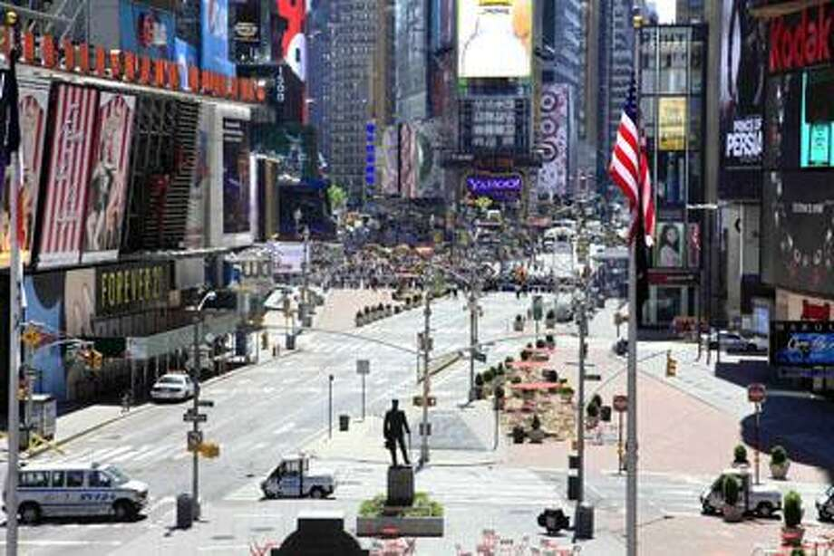 Authorities clear streets around New York's Times Square and called in the bomb squad Friday, May 7, 2010, after finding a cooler left on a sidewalk a block away from where where a failed car bomb was found over the weekend. (AP Photo/Mark Lennihan) Photo: AP / AP