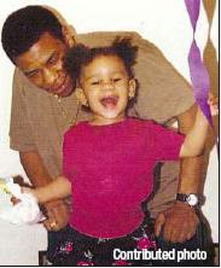Malik Jones and his daughter, Priya, in this photo from the mid-1990s.