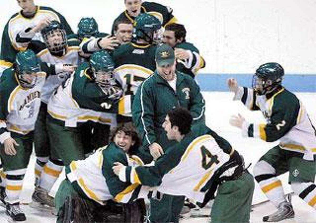Hamden goalie Anthony Avitable, front and center, Paul Amarone (4) and the rest of the Green Dragons claimed the No. 1 spot in the final boys' hockey Register Top 10 poll. (Peter Casolino/Register)