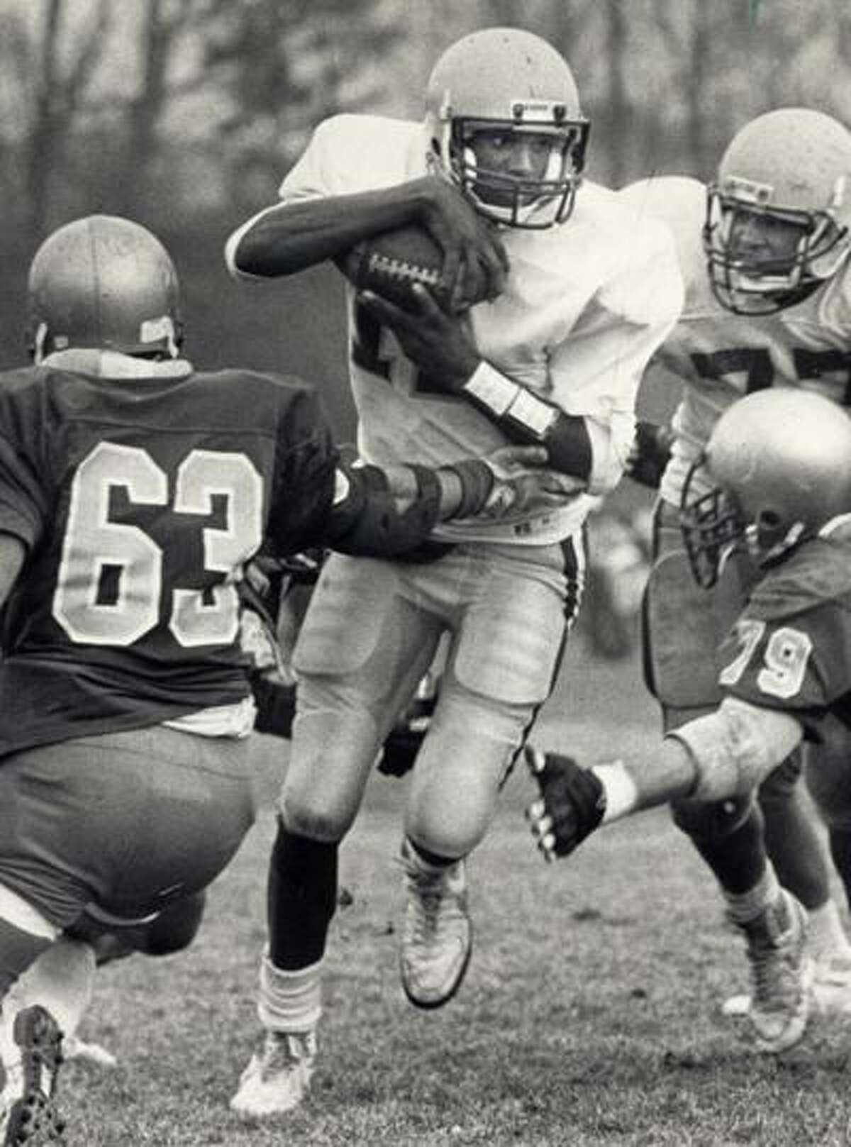 Qb Scott Burrell playing football during career at Hamden high School.