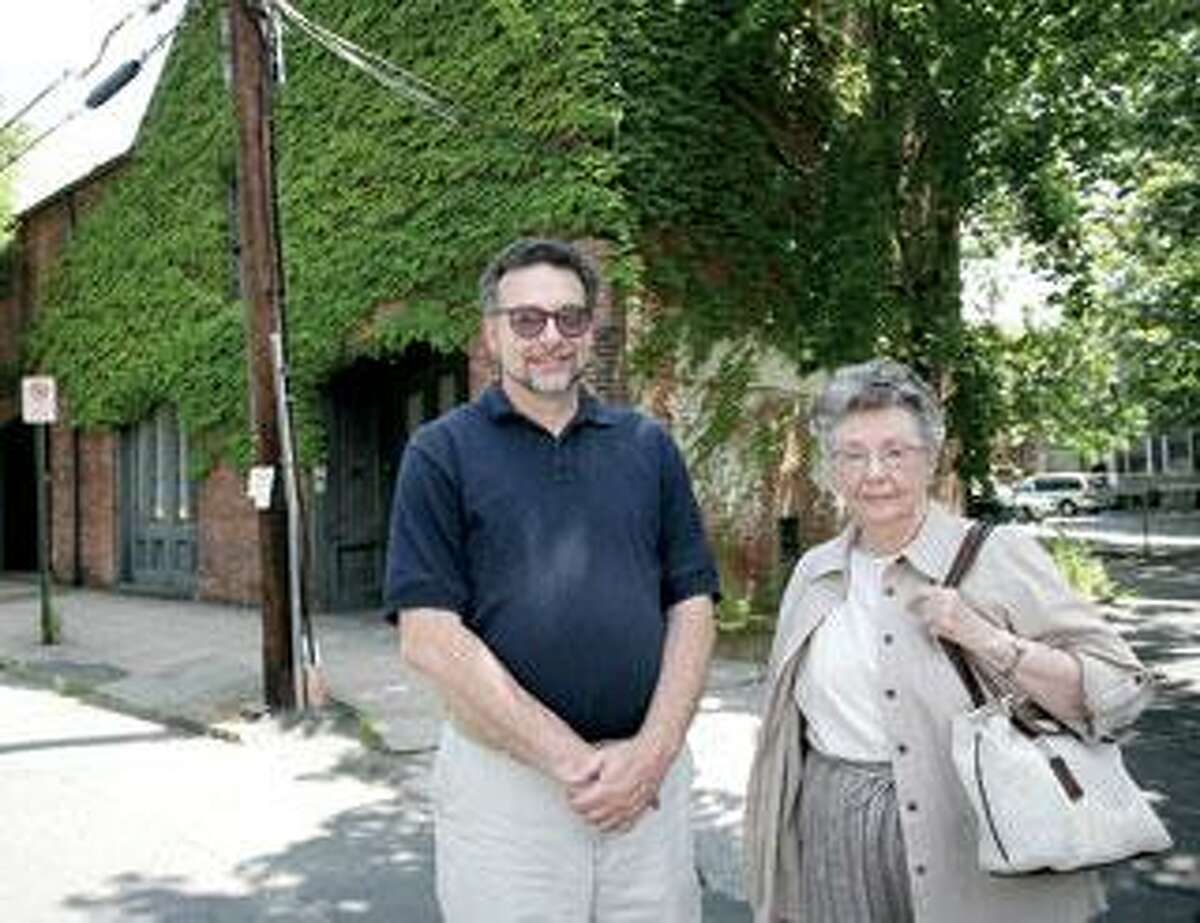 John Herzan and Marianne Mazan of the New Haven Preservation Trust are our intrepid carriage house tour guides, standing in front of a Lincoln Street carriage house. (Peter Casolino/Register photo)