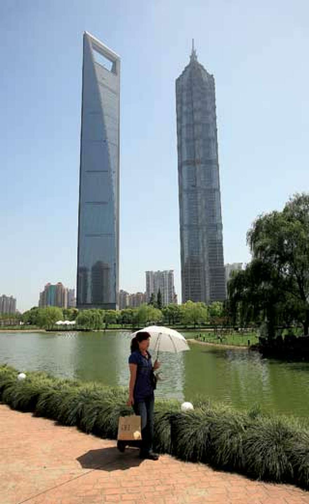 The 53rd to 87th floors of Jin Mao Tower, right, are occupied by the Grand Hyatt Shanghai, the highest hotel in the world. The Shanghai World Financial Center is the other tall building. (AP Photo)