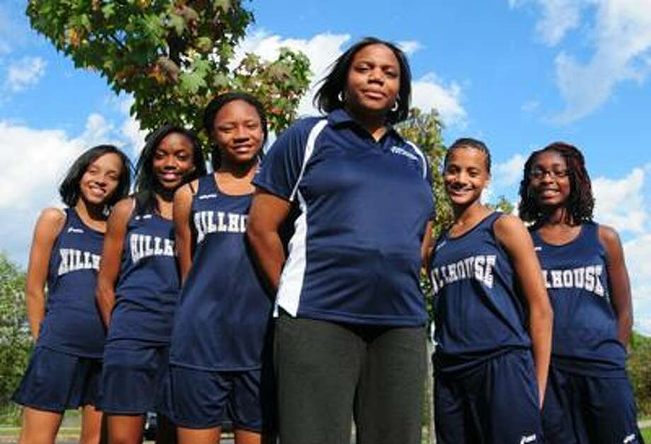 First-year coach Michele Moore, third from right, has the Hillhouse cross country team headed for success. From left are runners Whitney Curtis, Kellie Davis, Precious Holmes, Sydney Curtis and Nia Ruth. (Brad Horrigan/Register)